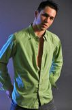 Male in green shirt stock image