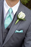 Male in grey suit with white rose Stock Photo