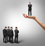 Male group stand under the other man which is on an increased hand of woman Royalty Free Stock Photos