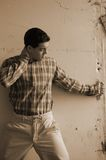 Male on grunge wall Stock Images