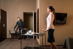 Male guest with suitcase coming into hotel room Stock Image