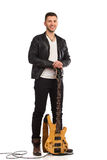 Male guitarist with bass guitar. Royalty Free Stock Images