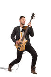 Male guitarist with bass guitar. Stock Photo