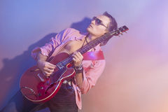 Male Guitarist Playing the Electric Guitar. Shot with Strobes an Stock Image