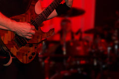 Male guitarist in a rock band stock photo