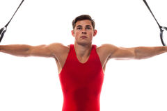 Male Gymnast. Young adult male gymnast. Studio shot over white Royalty Free Stock Photos