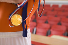 Male gymnast with gold medal, mid section Stock Photo