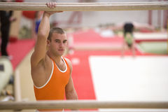Male gymnast, hand on parallel bars, portrait Royalty Free Stock Photography