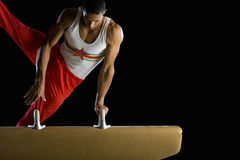 Male gymnast performing on pommel horse stock photos