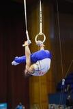 Male gymnast performing on pommel horse. Kyiv. Ukraine-April 1, 2017 : Male gymnast performing on pommel horse during Stella Zakharova Artistic Gymnastics Cup Royalty Free Stock Photography