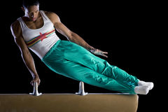 Male gymnast performing on pommel horse, low angle view Stock Images