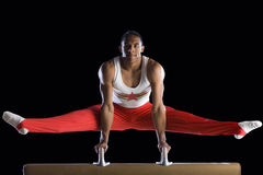 Male gymnast performing on pommel horse, portrait, low angle view Royalty Free Stock Photos