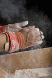 Male gymnast powdering hands, close-up of hands Royalty Free Stock Images