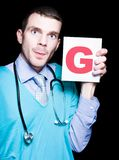 Male Gynaecologist Doctor Holding Gynaecology Sign Stock Photography