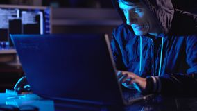 Male hacker celebrates success with a hand gesture. A successful attempt at system hacking and data theft. The concept of cybersecurity stock footage