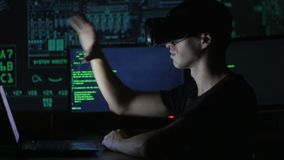 Male hacker programmer uses a virtual reality helmet for programming. IT Technologies of the Future. stock footage