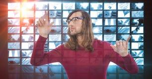 Male hacker touching screen Royalty Free Stock Photo