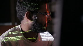 Male hacker works on a computer with data on screens. stock footage