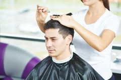 Male Hairdresser At Work Royalty Free Stock Images