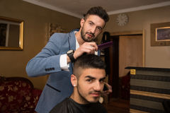 Male Hairdresser Cutting Hair Of Smiling Man Client Royalty Free Stock Image