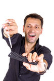 Male hairdresser with scissors and comb. Cutting Royalty Free Stock Photos