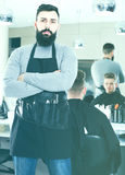 Male hairdresser showing his workplace and tools at hair salon Stock Photography