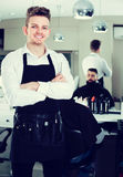 Male hairdresser showing his workplace and tools at hair salon Stock Photo