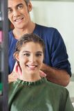 Male Hairdresser Wiping Client's Hair Stock Images