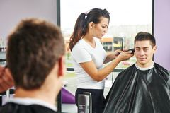 Male hairdresser at work Stock Images