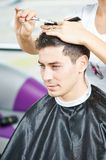 Male hairdresser at work stock photos