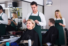 Male hairdresser at the work Royalty Free Stock Photos
