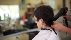Male hairstyle in salon. Man hair drying in barber shop. 1920x1080. Hd stock video footage