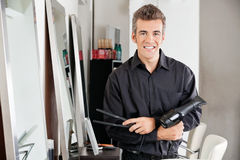 Male Hairstylist With Hairdryer And Straightener Stock Image