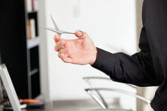 Male Hairstylist's Hand Holding Scissors Royalty Free Stock Photo