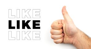 Male hairy hand shows thumb up and symbolizes approval sign, like, ok, good mood isolated on white background with space for text.  stock photos