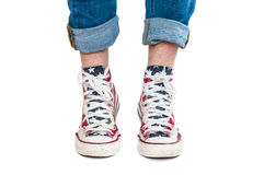Male hairy legs in red gumshoes Royalty Free Stock Images
