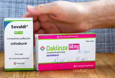 Male hand above Sovaldi 12-week treatment costs $84,000 in the U. PARIS, FRANCE - FEB 9, 2017: Male hand above Sovaldi 12-week treatment costs $84,000 in the Stock Photo