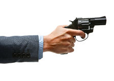 Male hand aiming revolver gun Stock Image