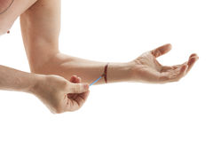 Male hand applying iodine. Isolated on white stock photos
