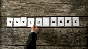 Male hand assembling the word Retirement Stock Photos