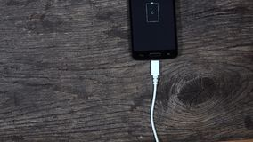 Male hand attach smart phones to charger wires stock footage