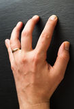 Male hand on black wall Royalty Free Stock Photos