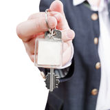 Male hand with blank door key fob close up Royalty Free Stock Photos