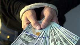 Male hand bound with the rope holding pile of money american dollar bank notes, financial rectrictions concept stock video footage