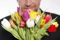Male hand with bouquet of tulips, isolated Stock Image