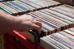 Male hand browisng vinyl records at flea market Stock Image