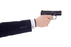 Male hand in business suit holding gun isolated on white Stock Photography
