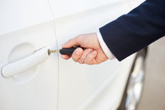 Male hand with car keys. Male hand holding key and opening car door Stock Photo