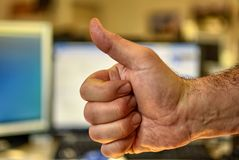 Male hand of Caucasian man makes thumbs-up gesture stock photography
