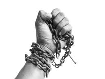 Male hand with chain. Male hand clench one's hand hole chain. business concept royalty free stock photo